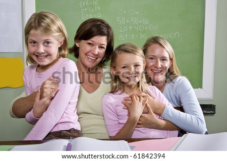 Back to school - teachers and elementary students in classroom, 8-9 years old - stock photo