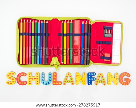 Back to School writing in german language - stock photo