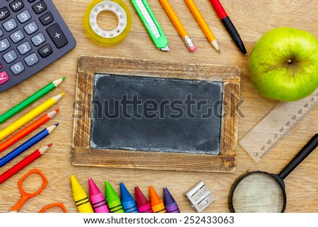 Back to School written on a blackboard, back to school background - stock photo