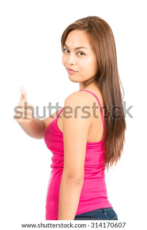 Back turned cute Asian woman with dyed brown hair, casually dressed in red tank top giving thumb up over the shoulder approving, showing satisfied, job well done - stock photo