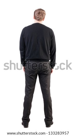 back view Business man looks ahead. Young guy in sweater watching. Rear view people collection. backside view of person.  Isolated over white background. office worker with his hands down looks ahead - stock photo