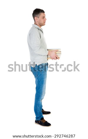 Back view going handsome man carries stack books. walking young guy. Rear view people collection. backside view person.  Isolated over white background. guy in a gray thoughtfully holds stack books. - stock photo
