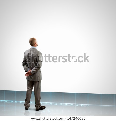 Back view image of businessman with arms crossed behind back. Place for text - stock photo