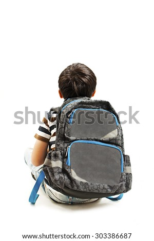 Back view Little schoolboy with schoolbag looking at empty copy space. Rear view. Isolated on white background   - stock photo