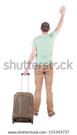 back view man with suitcase. brunette guy waves his hand.  backside view person.  Rear view people collection. Isolated over white background. guy with travel bag waving to someone in the distance - stock photo