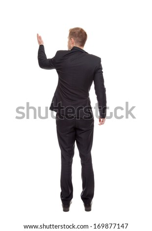 Back view of a business man pointing hand - stock photo