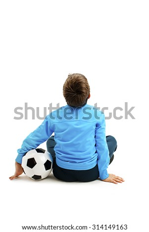 Back view of a child in sportswear with soccer ball. Isolated on white background   - stock photo