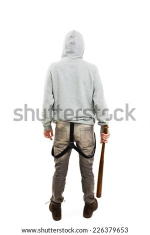 Back view of a  guy holding a baseball bat symbolizing crime. Isolated on white background   - stock photo