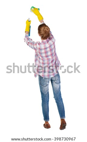 Back view of a housewife in gloves with sponge and detergent. girl  watching. Rear view people collection.  backside view of person.  Isolated over white background. cleaner washes a window - stock photo