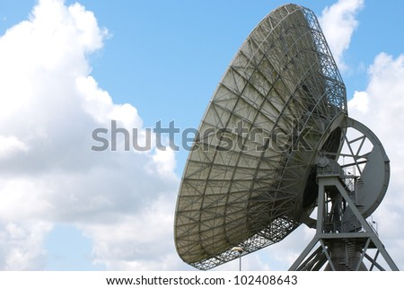 Back view  of a large satellite dish for communication - stock photo