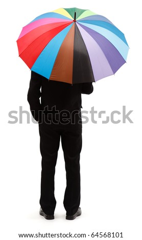 Back view of a man with big, colorful umbrella - stock photo