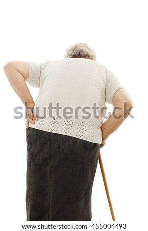 Back view of a old woman with back pain. Rear view people collection. Isolated on white background  - stock photo