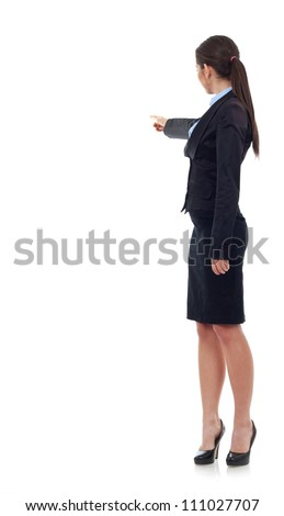 Back view of a young business woman pointing with her right hand, on white background - stock photo