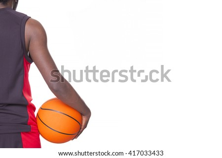 Back view of afro american basketball player holding a ball, isolated on white background - stock photo