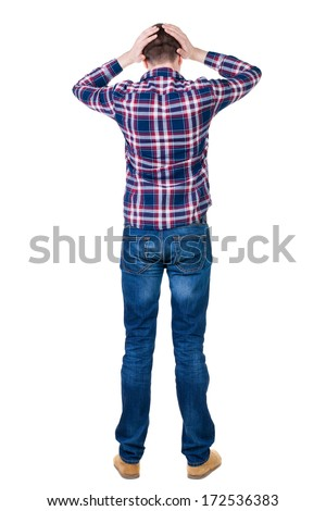 Back view of angry young man in jeans and checkered shirt. Rear view. isolated over white. backside view of person.  Rear view people collection. Isolated over white background. - stock photo