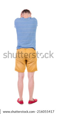 Back view of angry young man in shorts and t-shirt. Rear view. isolated over white. backside view of person.  Rear view people collection. Isolated over white background. - stock photo