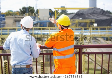 Back view of architects inspecting construction site - stock photo