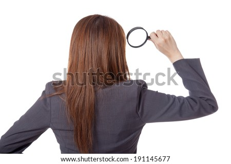 Back view of Asian businesswoman use magnifying glass isolated on white background - stock photo