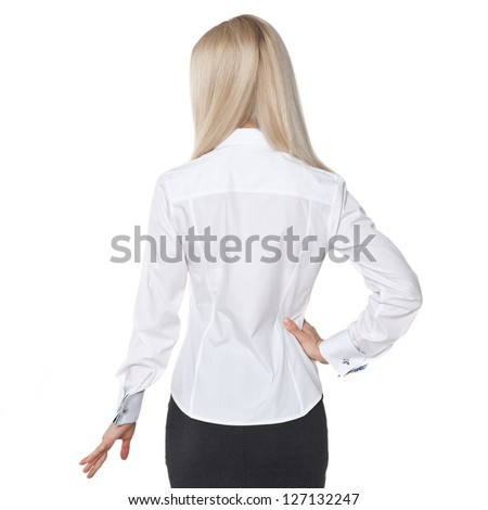back view of beautiful blonde business woman.Young girl in black skirt and white blouse.  Isolated over white background. - stock photo