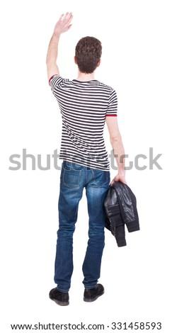Back view of beautiful man welcomes. man hand waving from. Rear view  people collection.  backside view of person.  Isolated over white background. Man holding a jacket in his left hand. - stock photo