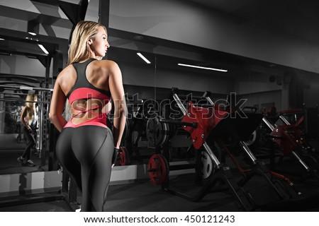 Back view of blondi sexy fitness girl - stock photo