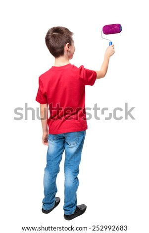 Back view of boy painting something with roller on white background - stock photo