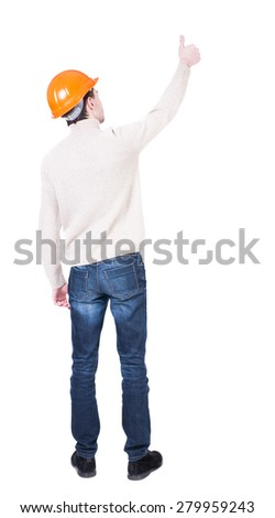 Back view of builder in helmet shows thumbs up.   Rear view people collection.  backside view of person.  Isolated over white background. Engineer approval shows a finger of his right hand. - stock photo