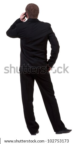 back  view of business man in black suit  talking on mobile phone. people collection. Rear view .  Isolated over white background. backside view of person. - stock photo