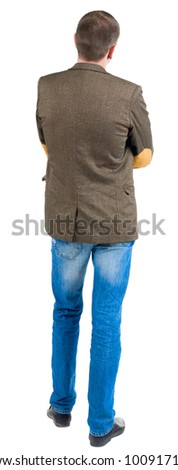 Back view of business man in jacket with patches on the sleeves looking ahead. Isolated over white background.  Standing young guy in jeans. Rear view people collection.  backside view of person. - stock photo