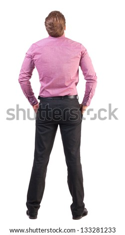 back view of Business man  looks ahead. Young guy in pink shirt watching.  Rear view people collection.  backside view of person.  Isolated over white background. - stock photo