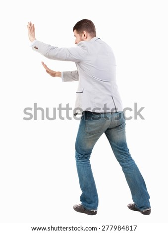 back view of business man pushes wall. Isolated over white background. Rear view people collection. backside view of person.  Bearded man ran into an obstacle. - stock photo