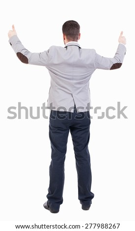 Back view of  business man shows thumbs up.   Rear view people collection. cheerful office worker shows positive emotions.  backside view of person.  Businessman with both hands showing signs success - stock photo