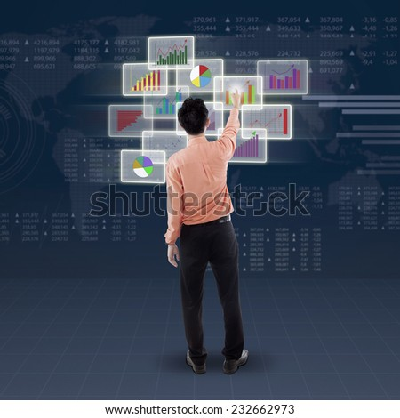 Back view of businessman choose and touch business chart on futuristic interface - stock photo