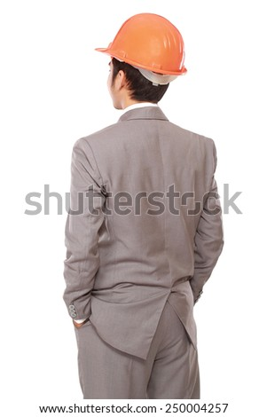 back view of businessman in orange builder's helmet isolated on white background - stock photo