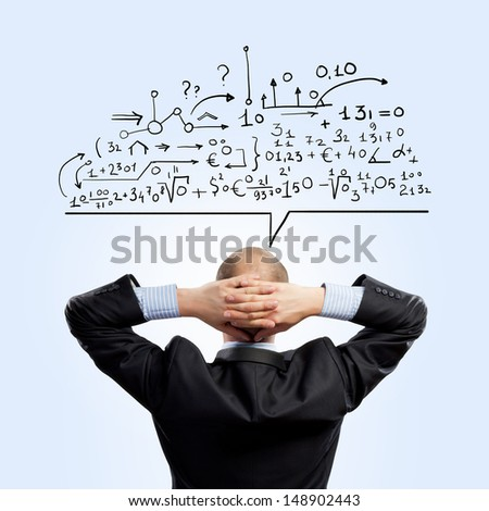 Back view of businessman looking at collage drawing - stock photo