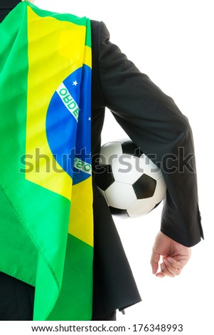 Back view of Businessman with soccer ball and Brazil flag - stock photo