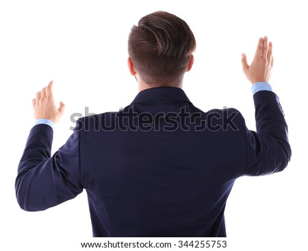 Back view of Caucasian young man in navy blue suit pointing, isolated on white - stock photo