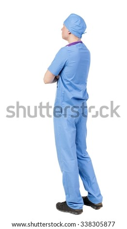 Back view of doctor in robe. Standing young guy. Rear view people collection.  backside view of person.  Isolated over white background. - stock photo