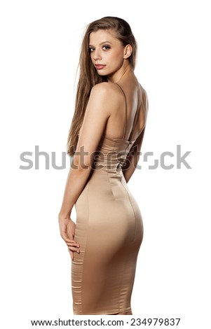 Back view of elegant young woman posing on a white background - stock photo