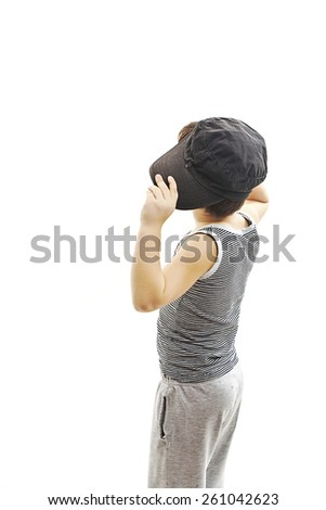 Back view of fashionable little boy.Hip-Hop Style  looking at wall. Pose Boy in Tracker Hat. Young Rapper. Funny Child in Cap. 5 years old. Rear view. Isolated on white background   - stock photo