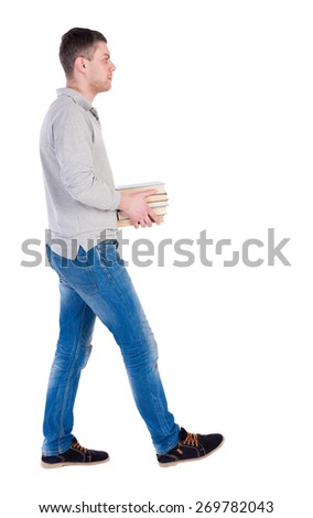 Back view of going  handsome man carries a stack of books. walking young guy . Rear view people collection.  backside view of person.  Isolated over white background. - stock photo
