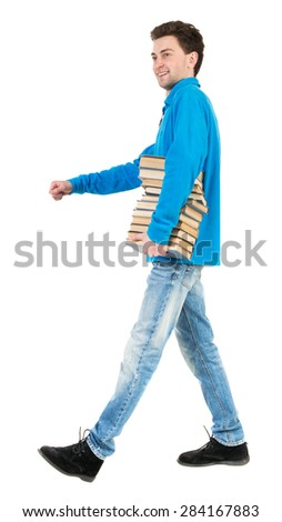 Back view of going  handsome man carries a stack of books. walking young guy . Rear view people collection.  Isolated over white background. Satisfied smiling senior carries books from the library. - stock photo