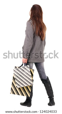 back view of going  woman  in  coat woman with shopping bags . beautiful brunette girl in motion.  backside view of person.  Rear view people collection. Isolated over white background. - stock photo