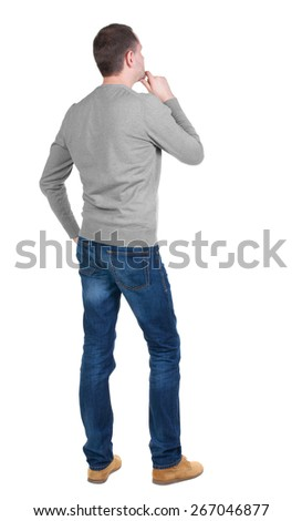 Back view of handsome man in blue pullover. Standing young guy in cardigan. Rear view people collection.  backside view of person.  Isolated over white background. - stock photo