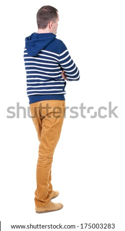 Back view of handsome man in striped hooded sweater. Standing young guy in jeans. Rear view people collection.  backside view of person.  Isolated over white background. - stock photo