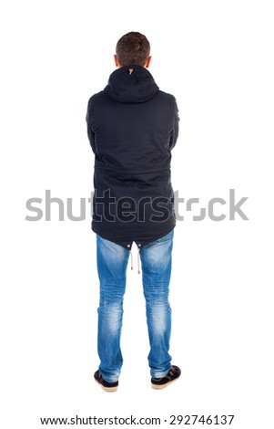 Back view of handsome man in winter jacket  looking up.   Standing young guy in parka. Rear view people collection.  backside view of person.  Man in warm jacket put his hands on his chest and costs. - stock photo