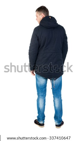 Back view of handsome man in winter jacket  looking up.   Standing young guy in parka. Rear view people collection.  backside view of person.  Isolated over white background.  - stock photo