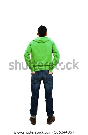 Back view of handsome with both hands in his pockets looking up. Standing young guy. Rear view people collection. backside view of person. Isolated over white background.  - stock photo