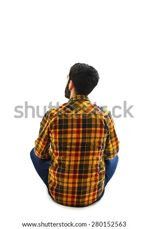 Back view of handsome young man, looks ahead. Isolated on white background   - stock photo