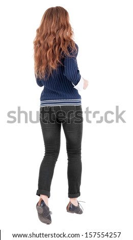back view of jumping  woman  in  jeans. beautiful redhead girl in motion. girl running quickly. backside view of person.  Rear view people collection. Isolated over white background. - stock photo